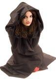 Frau im schwarzen Kostüm Stockfotografie