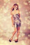 Frau im silbernen Kleid Stockbilder