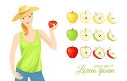 Frau im Strohhut, der roten Apfel hält Stockbild