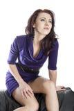 Frau im violetten Kleid Stockbilder