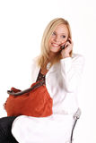 Frau im Weiß mit Telefon Stockbilder