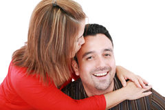 Frau küsst ihren Ehemann lizenzfreie stockfotografie