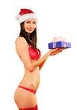 Frau Klaus im roten Bikini Stockfoto