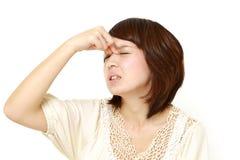 Frau leidet unter Asthenopia Stockfotografie