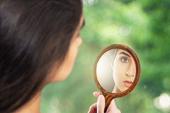 Frau in the mirror Stock Photo