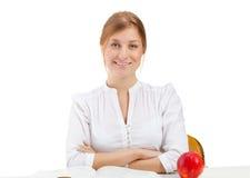 Frau mit Apfel und Buch Stockbilder