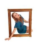 Frau mit Bilderrahmen Stockfotos