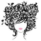Frau mit Blumen im Haar Stockbild
