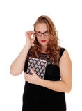 Frau mit Buch und Gläsern Lizenzfreie Stockfotos