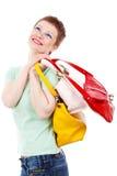 Frau mit bunten Beuteln Lizenzfreie Stockfotografie