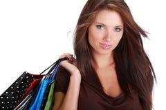 Frau mit bunter Einkaufstasche Stockfotografie
