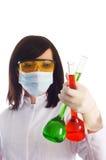 Frau mit chemischen Gefäßen Stockfoto