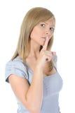 Frau mit dem Finger auf Lippen Lizenzfreie Stockbilder