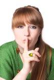 Frau mit dem Finger auf Lippen Lizenzfreie Stockfotos