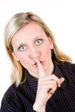 Frau mit dem Finger zu den Lippen Lizenzfreies Stockbild