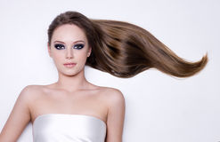 Frau mit dem lang geraden glatten Haar Stockbilder