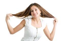Frau mit dem langen braunen Haar Stockbilder
