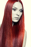 Frau mit dem langen roten Haar Stockfotos