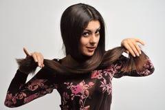 Frau mit dem schönen Haar stockbild