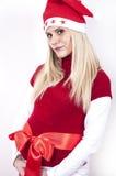 Frau mit dem Weihnachtshut, der ihren Bauch anhält Lizenzfreies Stockfoto