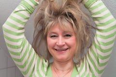 Frau mit dem wilden Haar Stockbilder