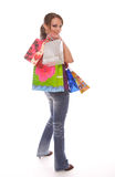Frau mit den Einkaufenbeuteln, die über Schulter schauen Lizenzfreie Stockfotos