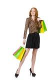 Frau mit den Einkaufstaschen lokalisiert Stockbilder