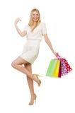 Frau mit den Einkaufstaschen lokalisiert Stockfotografie