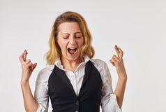Frau mit den Fingern gekreuzt Stockbilder
