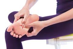 Frau mit den Fußschmerz Stockfoto