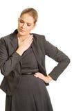 Frau mit den schrecklichen Kehlschmerz Stockfotografie