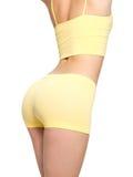 Frau mit den sportlichen Hinterteilen und dünner Taille Lizenzfreies Stockbild