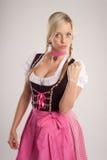 Frau mit Dirndl warnt mit der Faust Lizenzfreies Stockbild
