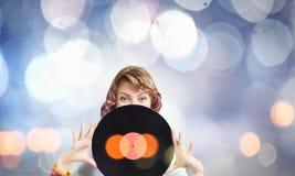 Frau mit Discoplatte Stockfoto