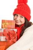 Frau mit drei Geschenken Stockbild
