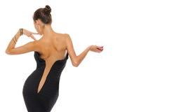 Frau mit einem aufgeknöpften Kleid und einem Glas Wein Lizenzfreies Stockbild