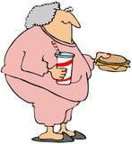 Frau mit einem Cheeseburger und einem Soda Stockfoto