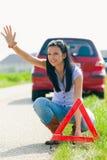 Frau mit einem Dreieck, das aufgegliedert hat Lizenzfreie Stockbilder