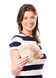 Frau mit einem Gebläse des Geldes Lizenzfreie Stockfotos