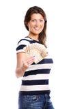 Frau mit einem Gebläse des Geldes Stockbilder