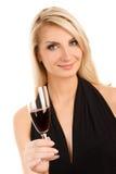 Frau mit einem Glas Rotwein Stockfotografie