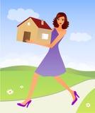 Frau mit einem Haus Stockfotografie