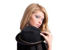 Frau mit einem Hut Stockbild