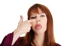 Frau mit einem lustigen Blick auf ihrem Gesicht Lizenzfreie Stockbilder