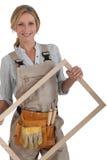 Frau mit einem Rahmen. Lizenzfreie Stockbilder