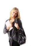 Frau mit einem schwarzen Beutel Stockfotos