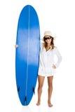 Frau mit einem Surfbrett Stockfotos
