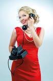 Frau mit einem Telefon Stockfoto