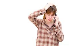 Frau mit einem Telefon in seiner Hand lizenzfreie stockbilder