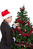 Frau mit einem Weihnachtsbaum lizenzfreies stockfoto
